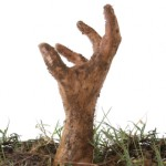 Hand emerging from the ground